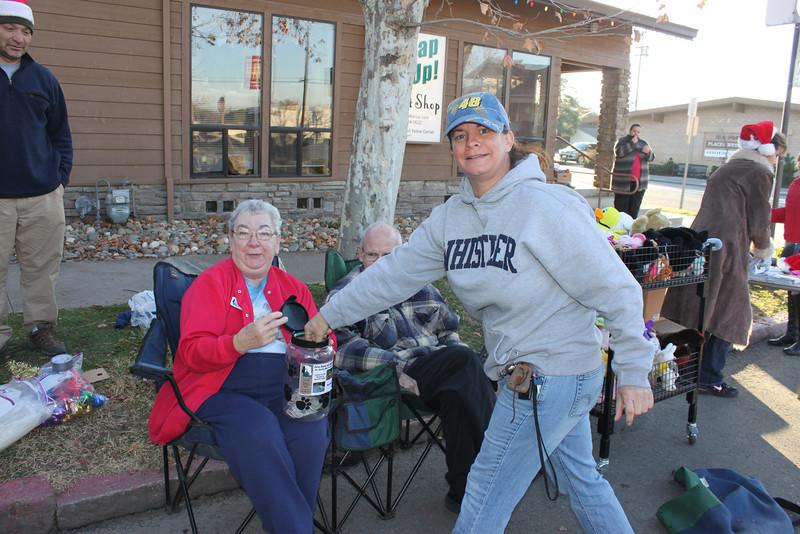 Board Member Reba Miller accepting donations.