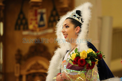 Fiesta de Santa Fe Coronation of Knight of Don Diego, Daniel Ray Diaz and La Reina de La Fiesta de Santa Fe, Brittany Ana Maria Sandanly Romero during the Novena de La Conquistadora Mass at the Cathedral Basilica of Saint Francis of Assisi followed by the processon of  the 29-inch Marian figure, La Conquistadora to the Rosario Chapel on Sunday, June 5, 2016. Tsering Choney/For The New Mexican