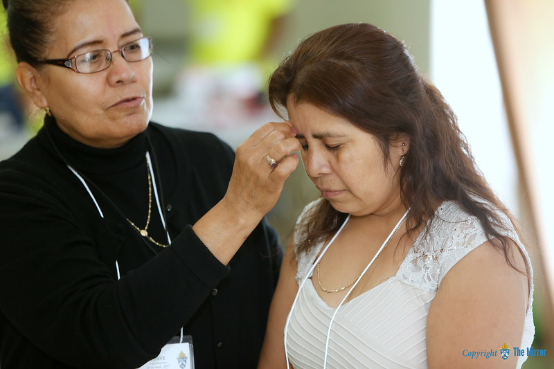 BLESSING—Delegates each received a blessing during their witness and discernment sessions before the liturgy celebrating the Diocesan V Encuentro Sept. 30 in Branson, MO. (Photo by Dean Curtis/<i>The Mirror</i>)