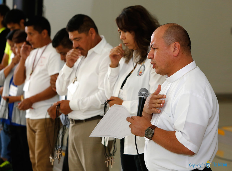 BLESSING OF DELEGATES—Father José Araque led a blessing during the Diocesan Encuentro held Sept. 30 at Our Lady of the Lake Parish in Branson. (Photo by Dean Curtis/<i>The Mirror</i>)