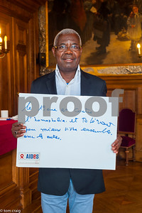 Paris, France, AIDS NGO AIDES, French People, Holding Protest Signs Against Discrimination, International Day Against Homophobia, IDAHOT, Portraits, Daouda Kouadio