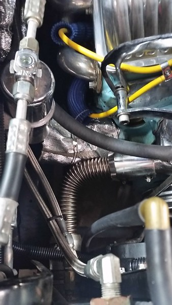 """Among the theories to minimize or eliminate vapor lock includes: A. insulate the fuel pump; B. Insulate the fuel line inside the engine compartment; C. Add a """"return line filter"""" (GM style) and run a return line back to the fuel tank; D. Add an electric fuel pump back at the fuel tank to assist """"clearing out"""" the fuel system before starting or operate the electric pump all the time. So here is the sequence of the """"fixes"""" in the order of """"easiness"""" and minimal cost. I insulated the mechanical fuel pump the best I could with a starter insulation kit. Ugly, but....well, that didn't work."""