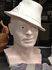 "My 5 year old nephew, Eric, looked at me in a sunhat and said, ""A Hat can be a kind of disguise....   ...Who ARE you!?!""   (This after I'd been visiting about a week).  <br /> Whence came my inspiration for this 3/4 life sized head, with various head gear.  More chapeaux's to come."