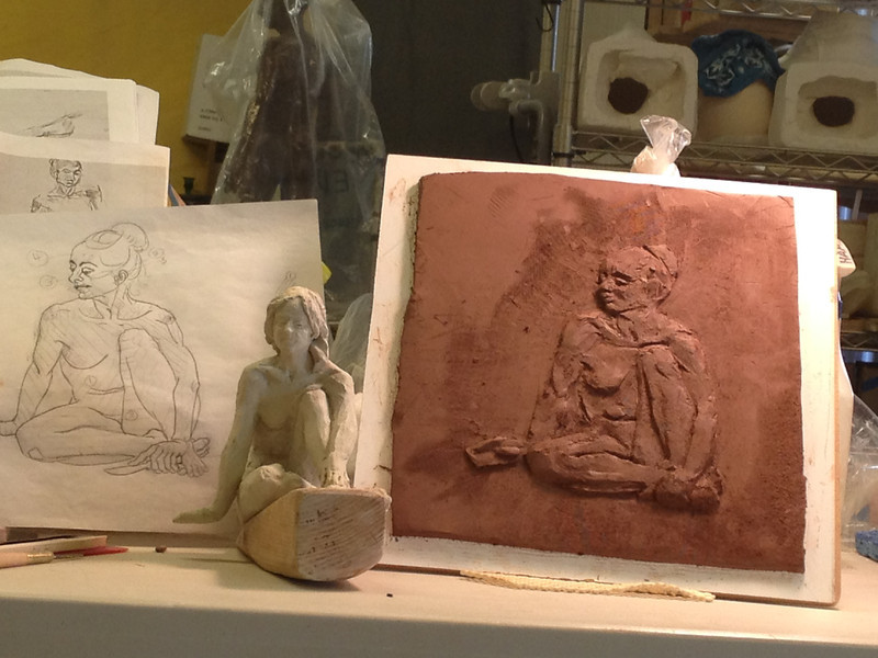 Drawing and start of Relief based on pose shown in following maquette sculpture.