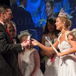 KDF Queen Madison Orman performs her first knighting.