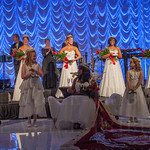 The Princesses fill the stage behind the 2015 Queen.