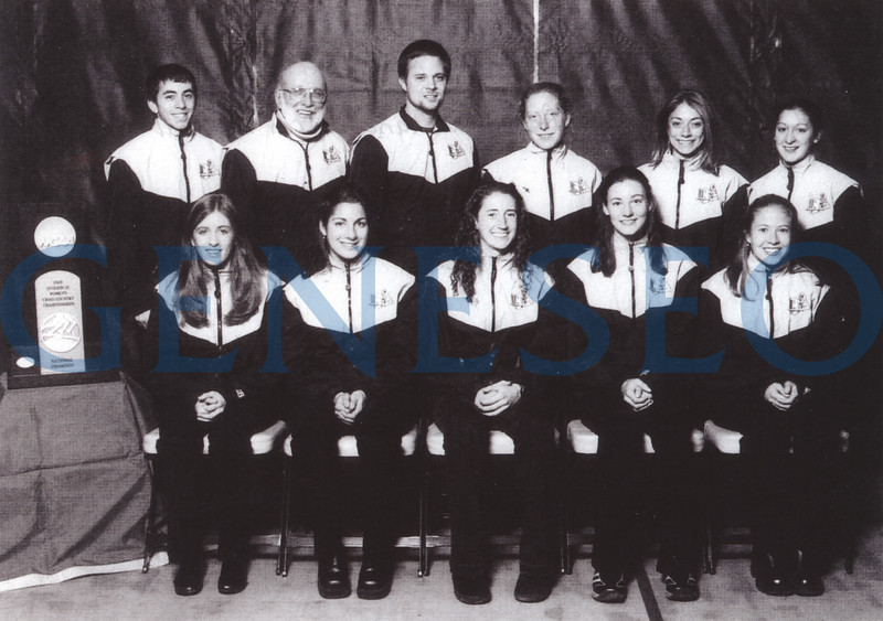 2005 NCAA Division III National Championship <br /> The women's cross-country team was the first Geneseo athletic team to win an NCAA Division III national championship. Photo: (front, from left): Shannon Griggs, Francesca Magri, Liz Montgomery, Marta Scott, Christy Finke; (back): assistant coach Jeff Beck, head coach Mike Woods, assistant coach Dave Prevosti, Christiana Martin, Renne Catalano, Karen Merrill (Bright Collection)