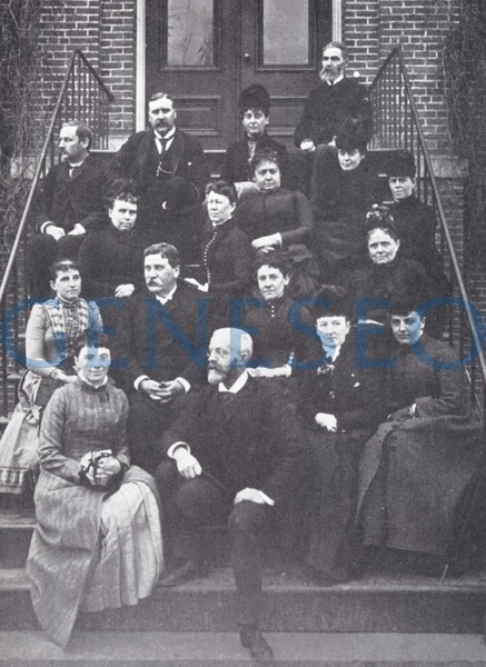 1890–91 100-Grad Graduation<br /> The normal school graduated its first class of over 100 students with 105 degree holders. Photo: The 1891 faculty included (first row, from left): Cora Northrup, Hubert Schmiz, Elizabeth McBride, Sara Goheen; (second row): Jennie Coe, William Milne, Maria Chichester, Emeline McMaster Curtiss; (third row): Phebe Hall, Mary Burns, Myra Burdick, Mary Parks; (fourth row): Frank Welles, John Milne, Marcia Heath Rowland, Sarah Parry; (top): Reuben Waterbury