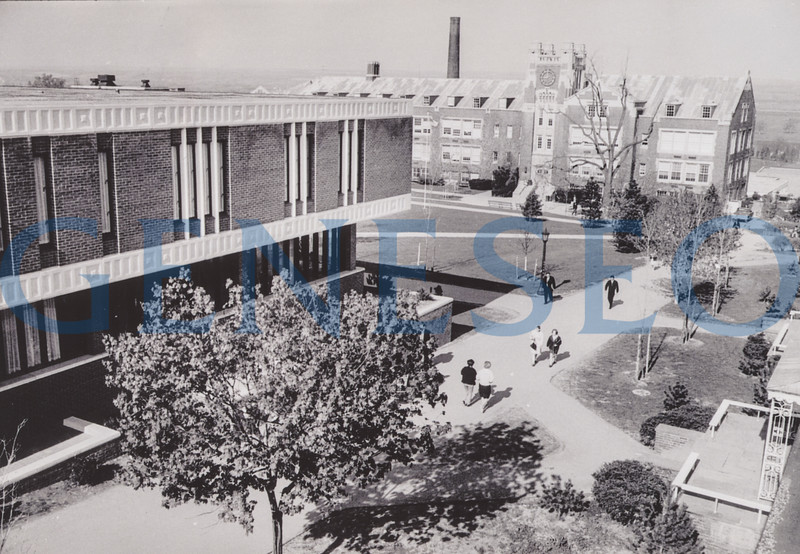 1967 Seven New Buildings <br /> The year saw a boom of new buildings on campus. Following recent tradition, college officials named Red Jacket Dining Hall after local history and Nassau and Suffolk residence halls after New York State counties. Photo: This 1968 photo shows the old a new administration buildings, Sturges and Erwin. (Milne Archives)