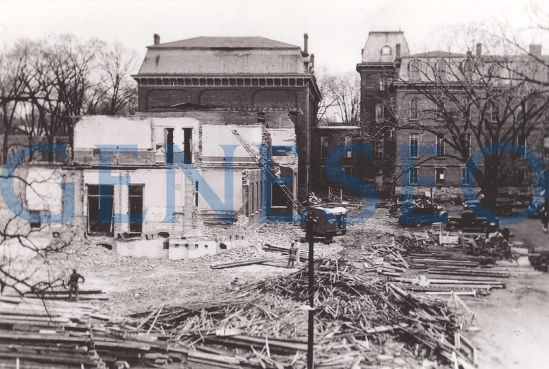 1951 Old Main Razed<br /> Old Main, the first building constructed for what was then the Normal School, had stood for 80 years and was increasingly dilapidated. Nevertheless, Old Main was a beloved symbol of the College, and induction into the Alumni Association's Society of Old Main was the highest honor for alumni. With the loss of their gymnasium, the college's sports teams began to use the athletic facilities at the Geneseo Junior-Senior High School (now Doty Hall)