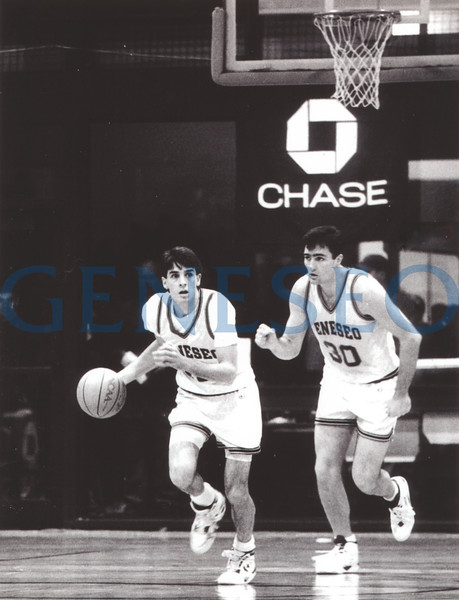 1994 Player of the Year<br /> Basketball standout Scott Fitch '94 was named Geneseo's first NCAA Division III Player of the Year. Photo: Scott Fitch (with ball) and Scott Tudman led the Blue Knights to victory in the 1993 Chase Tournament. Fitch was the leading scorer and tournament MVP. (Tom Murphy, Bright Collection)