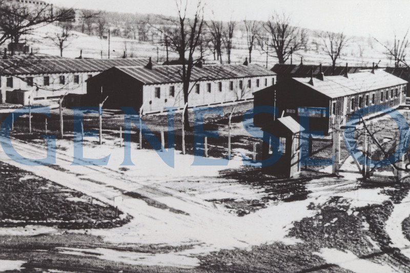 1945 Prisoners of War Near Campus<br /> German and Italian prisoners of war were held in a camp (ten prefabricated buildings) near where the track and field complex is today. Photo: A prisoner of war camp was built in 1945 near a canning factory at the lower end of Court Street. (Bright Collection)