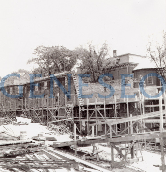1950–51 Blake A–E Opened to Students<br /> Blake was originally subdivided into A, B, C, D, and E sections, which were named College Center, Bailey, Fraser, Blake, and Sturges respectively. Blake B–E comprised four residence halls that housed 200 students, each of whom paid $145 per ten-week quarter for room and board. The building's name honored Anne S. Blake, whose 17-year tenure at the College included service as Dean of Women from 1921 until her retirement in 1934. Blake D and E were razed in 2004; the remaining Blake buildings now house faculty offices. [PHOTO: Photo of one of the halls with students in them][photos of Blake construction AND completed Blake buildings.