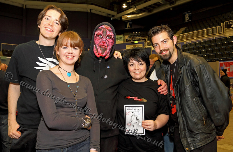 Fan with Cast and Comic Book