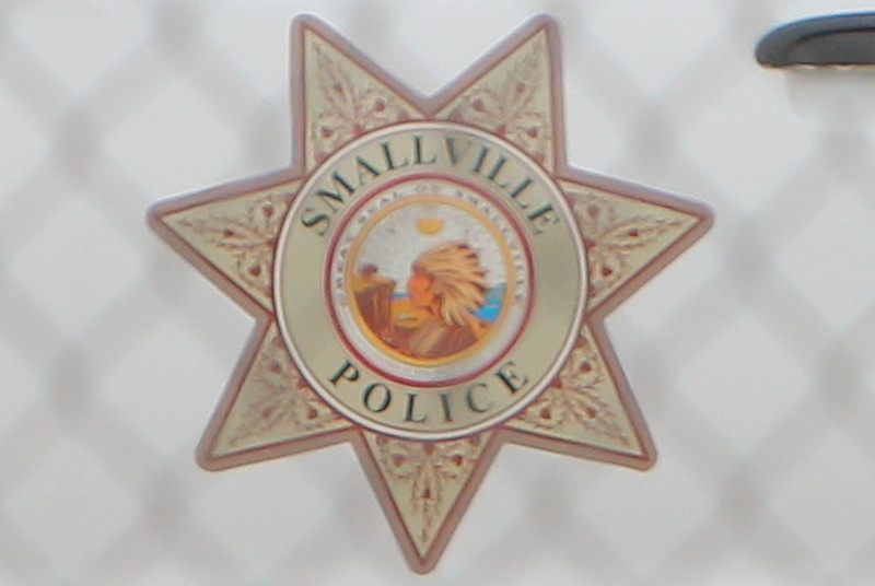 "Description: Smallville Police Car Insignia in Smallville (Set) <br /> <br /> Media: Photo<br /> <br /> Copyright: Gregory Zonsius<br /> Attribution: To use or link to this media you must include ""Courtesy of <a href=""mailto:greg@zoncom.com/"">Gregory Zonsius</a> 