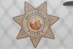 """Description: Smallville Police Car Insignia in Smallville (Set) <br /> <br /> Media: Photo<br /> <br /> Copyright: Gregory Zonsius<br /> Attribution: To use or link to this media you must include """"Courtesy of <a href=""""mailto:greg@zoncom.com/"""">Gregory Zonsius</a> 