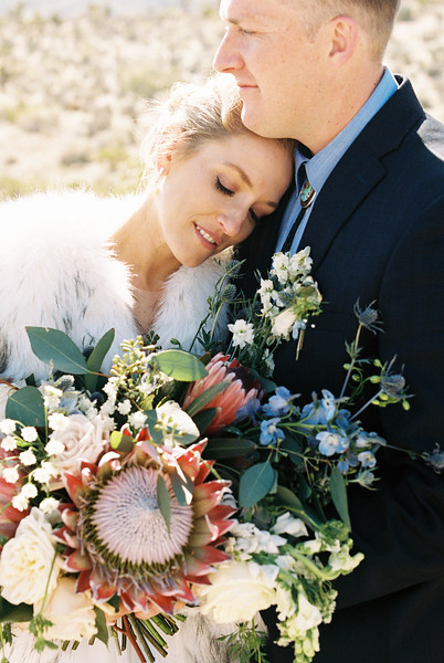 Winter elopement with a Protea Bouquet