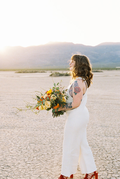 Vegas elopement | colorful bouquet and bridal romper / Kristen Kay Photography
