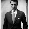 American actor, Gary Cooper looking into camera wearing a suit and tie
