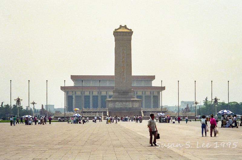 Monument for heroes with the Great Hall of the People in the background.