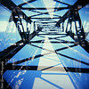 Double exposure of the pedestrian bridge over the railroad tracks in Laramie, WY - August 8, 2010