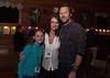 Half of the Adams family foursome, John Adams and daughter sandwiching RIFF Program Director Tonya Skoog.