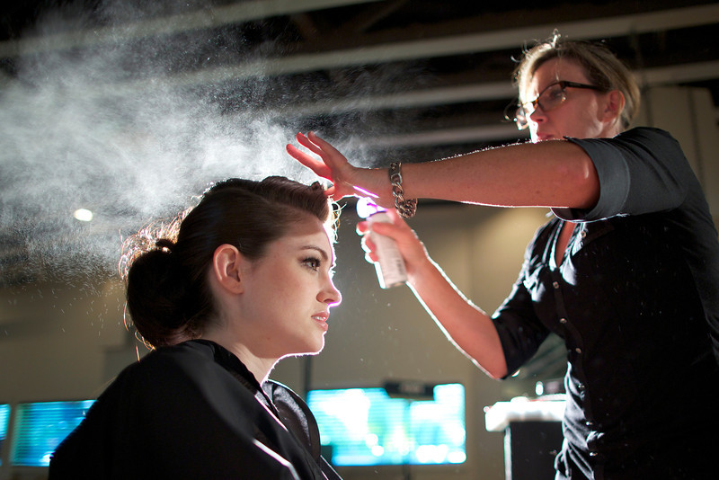 Judy Worth styling the models hair before shoot.