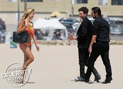 Shauna Sand Struggles To Walks On The Beach In Revealing Orange Bikini & Shows Off Her Huge Lips!