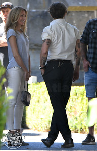 EXC: Johnny Depp Shows Off Tattoos & Chats With Mystery Girl
