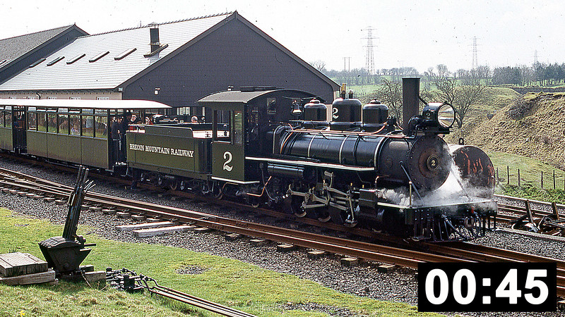 The Brecon Mountain Railway's Baldwin 4-6-2 no 2 departs from Pant on 26th March 2005.<br /> (45 sec.)