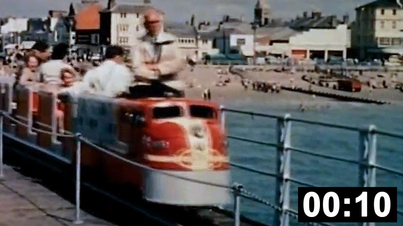 "Two seaside miniature railways: A clip of the Blackpool Pleasure Beach Railway, a 21 inch gauge line which opened in  in 1933. <br>Featured is  a Hudswell Clarke loco, 'Mary Louise' based on an LNER pacific.   This is followed by a rare clip of the 10¼"" gauge<br> Bognor Pier line (1951 to c1965), one of the few pier railways in existence in the mid 20th century. This shows Santa Fe 619 built by E. Johnstone in c1957,<br> originally as a trackless train for Kerr's Miniature Railway. Renowned locomotive builder Mr Hunt rebuilt her <br>as a 4w-4wPM loco for use at Bognor before it was moved back to Scotland.  (10sec. No sound)."