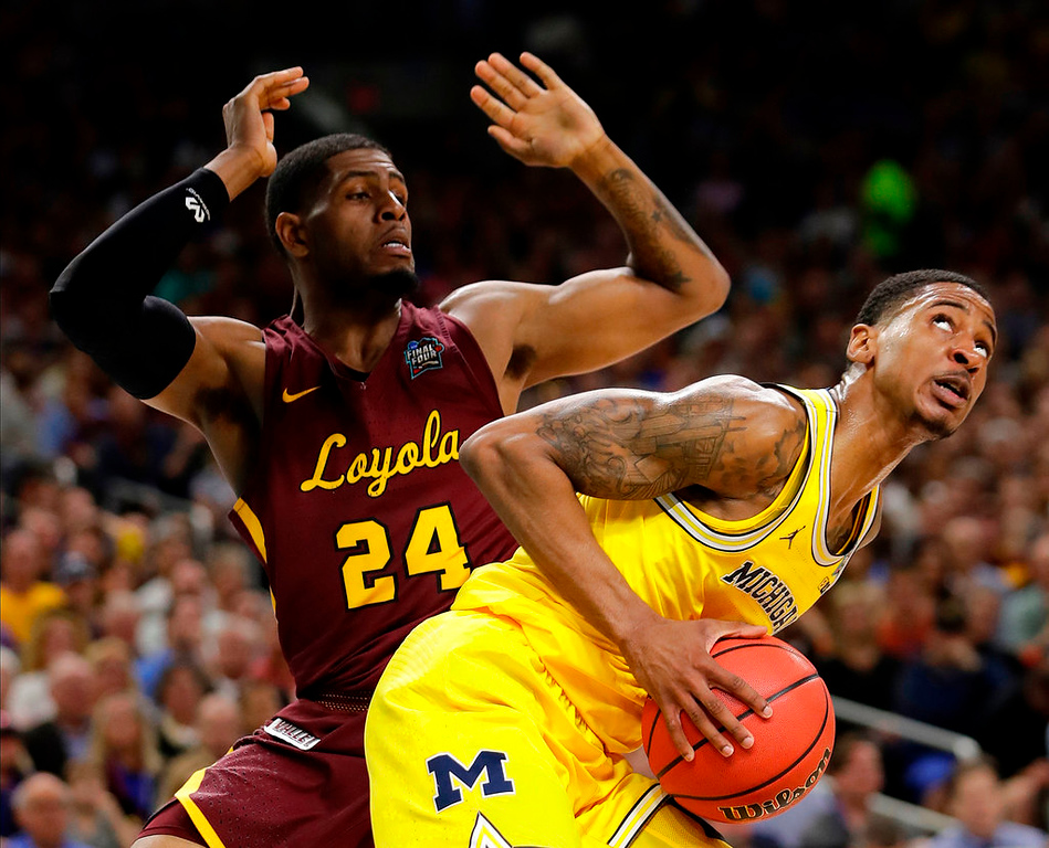 . Michigan\'s Charles Matthews looks to shoot against Loyola-Chicago\'s Aundre Jackson (24) during the first half in the semifinals of the Final Four NCAA college basketball tournament, Saturday, March 31, 2018, in San Antonio. (AP Photo/Eric Gay)