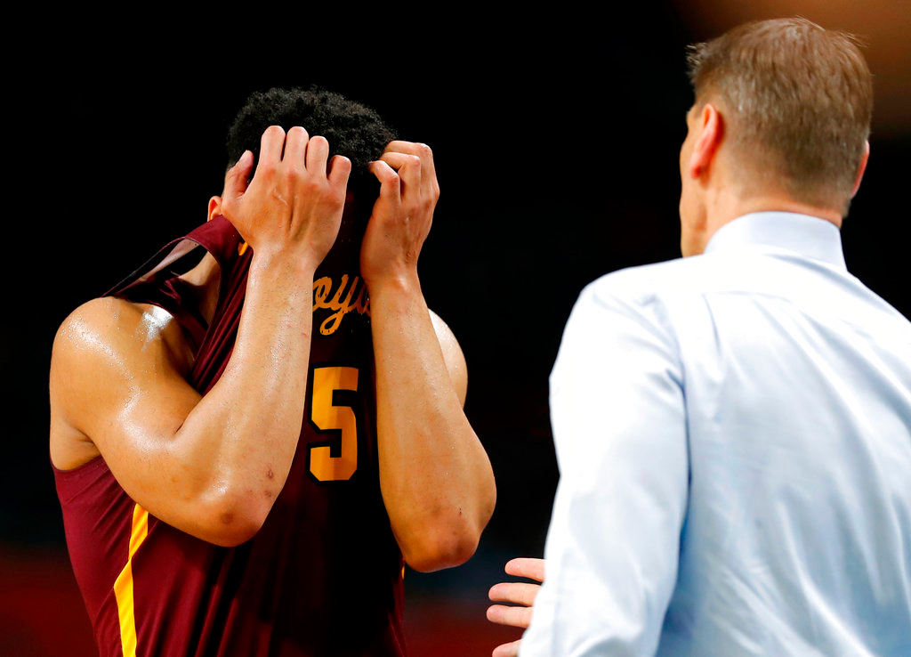 . Loyola-Chicago guard Marques Townes, left, reacts in front of head coach Porter Moser during the second half against Michigan in the semifinals of the Final Four NCAA college basketball tournament, Saturday, March 31, 2018, in San Antonio. (AP Photo/Charlie Neibergall)
