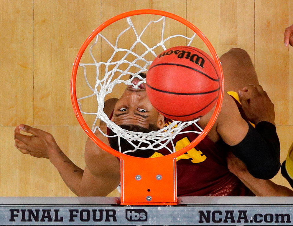 . Loyola-Chicago\'s Aundre Jackson (24) watches a shot under the basket during the second half in the semifinals of the Final Four NCAA college basketball tournament against Michigan, Saturday, March 31, 2018, in San Antonio. (AP Photo/David J. Phillip)