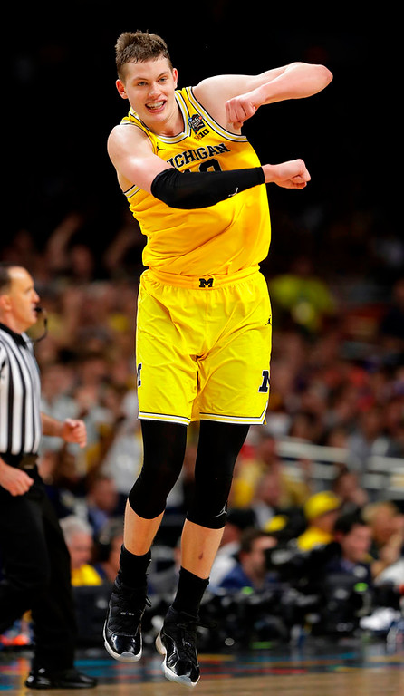 . Michigan\'s Moritz Wagner (13) reacts during the second half in the semifinals of the Final Four NCAA college basketball tournament against Loyola-Chicago, Saturday, March 31, 2018, in San Antonio. (AP Photo/Eric Gay)