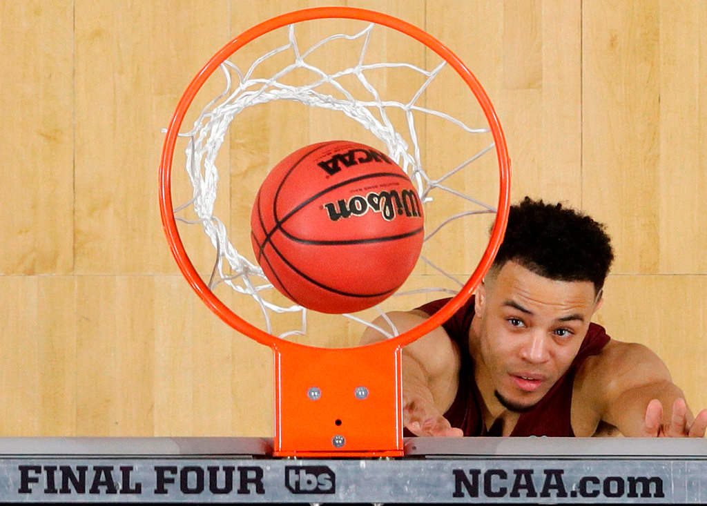 . Loyola-Chicago\'s Marques Townes watches his shot during the second half in the semifinals of the Final Four NCAA college basketball tournament against Michigan, Saturday, March 31, 2018, in San Antonio. (AP Photo/David J. Phillip)