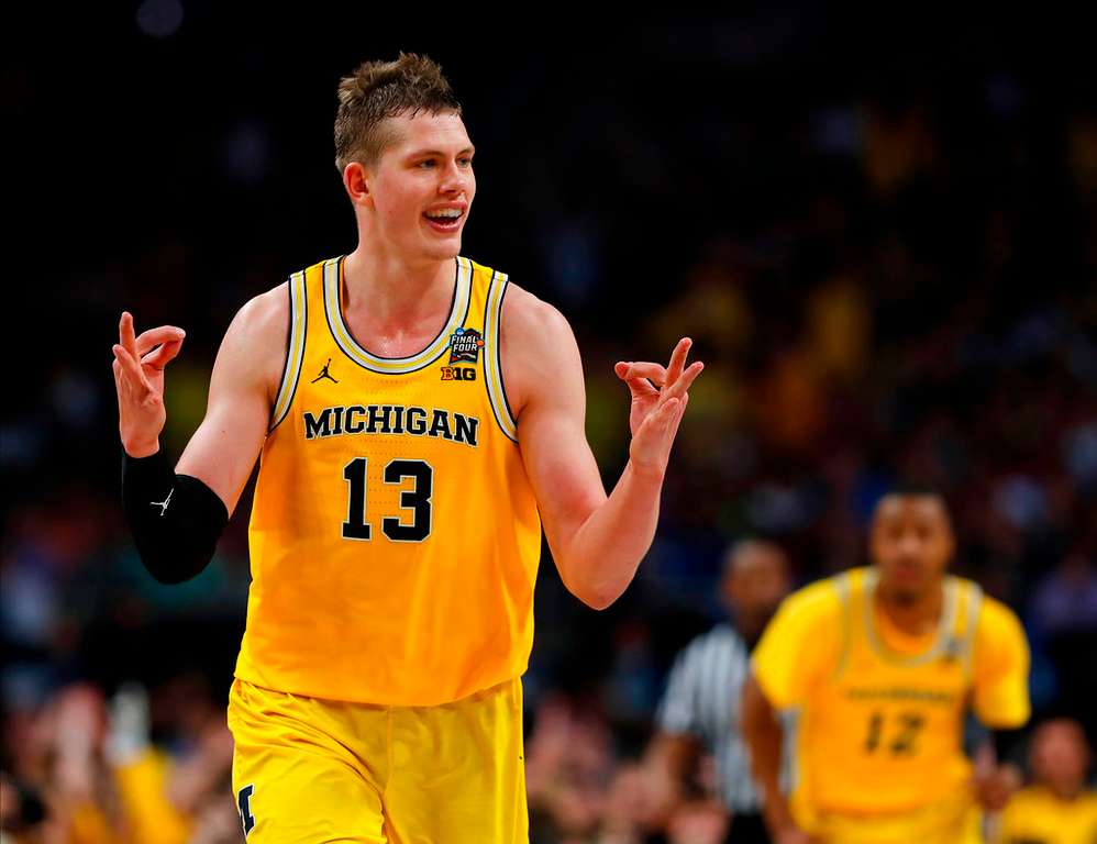 . Michigan\'s Moritz Wagner (13) reacts after scoring a 3-point shot against Loyola-Chicago during the second half in the semifinals of the Final Four NCAA college basketball tournament, Saturday, March 31, 2018, in San Antonio. (AP Photo/Charlie Neibergall)