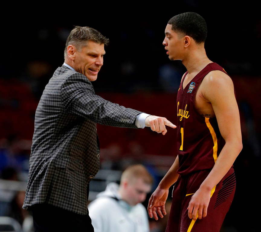 . Loyola-Chicago head coach Porter Moser, left, talks with guard Lucas Williamson during the first half against Michigan in the semifinals of the Final Four NCAA college basketball tournament, Saturday, March 31, 2018, in San Antonio. (AP Photo/David J. Phillip)