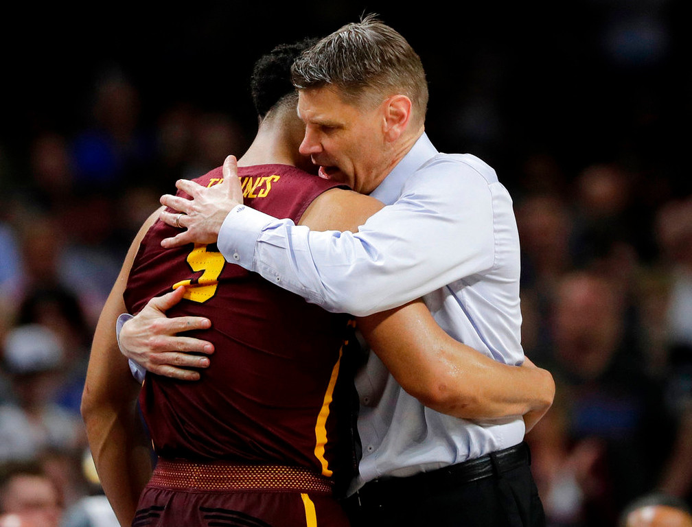 . Loyola-Chicago head coach Porter Moser hugs Marques Townes (5) during the second half in the semifinals of the Final Four NCAA college basketball tournament against Michigan, Saturday, March 31, 2018, in San Antonio. (AP Photo/David J. Phillip)