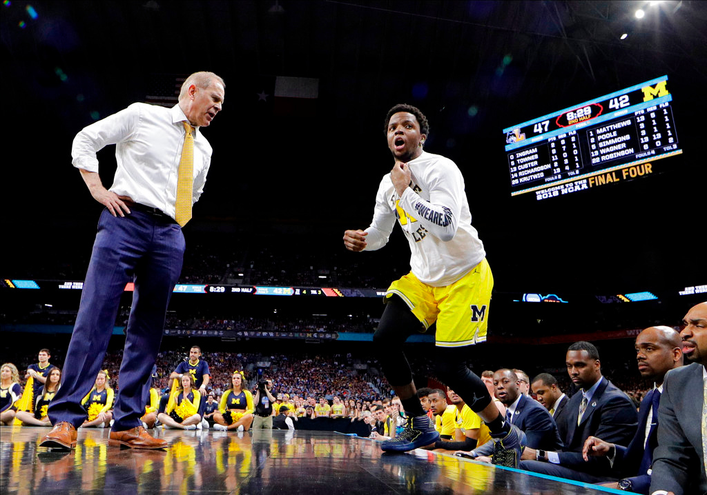 . Michigan head coach John Beilein talks with guard Zavier Simpson, right, during the second half against Loyola-Chicago in the semifinals of the Final Four NCAA college basketball tournament, Saturday, March 31, 2018, in San Antonio. (AP Photo/David J. Phillip)