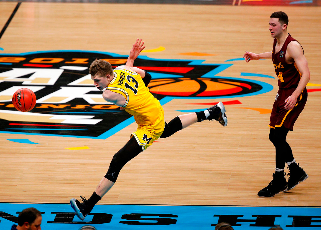. Michigan\'s Moritz Wagner (13) chases the loose ball during the second half in the semifinals of the Final Four NCAA college basketball tournament against Loyola-Chicago, Saturday, March 31, 2018, in San Antonio. (AP Photo/Brynn Anderson)