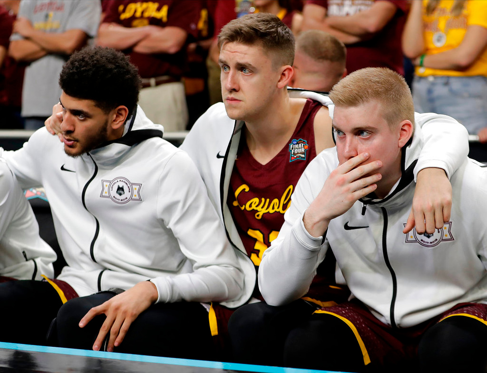 . Loyola-Chicago players on the bench react during the second half in the semifinals of the Final Four NCAA college basketball tournament against Michigan, Saturday, March 31, 2018, in San Antonio. (AP Photo/Eric Gay)