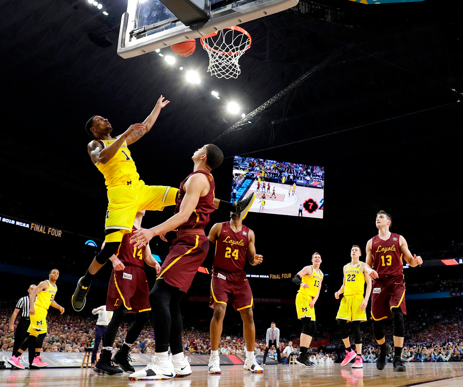 . Michigan\'s Charles Matthews (1) goes up for a basket during the second half in the semifinals of the Final Four NCAA college basketball tournament against Loyola-Chicago, Saturday, March 31, 2018, in San Antonio. (AP Photo/David J. Phillip)