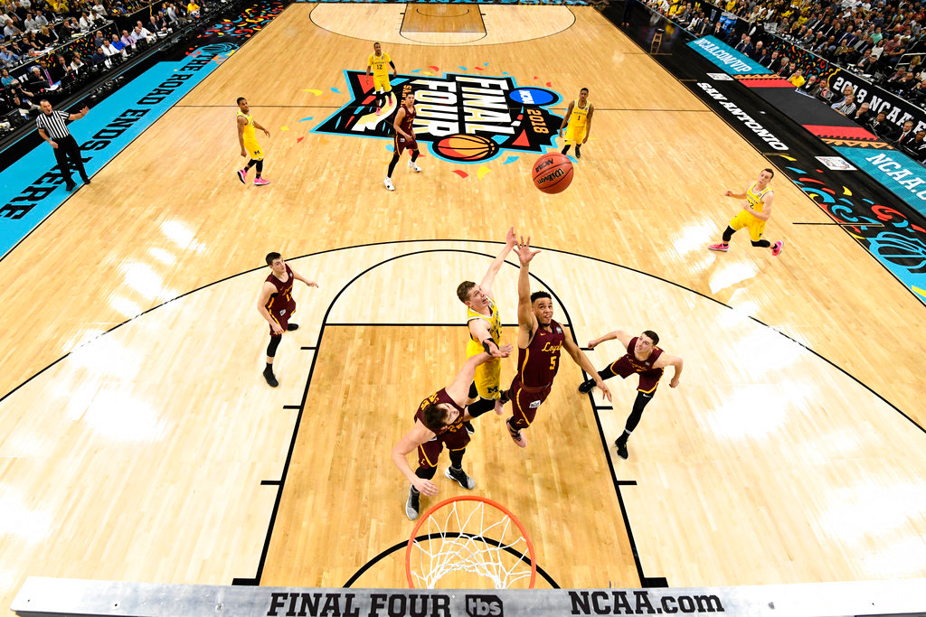 . Loyola-Chicago guard Marques Townes (5) drives to the basket past Michigan forward Moritz Wagner during the second half in the semifinals of the Final Four NCAA college basketball tournament, Saturday, March 31, 2018, in San Antonio. (AP Photo/Chris Steppig, NCAA Photos Pool)