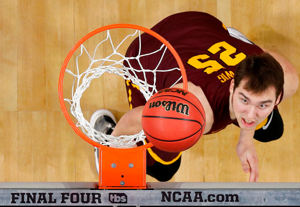 . Loyola-Chicago\'s Cameron Krutwig (25) watches his shot during the second half in the semifinals of the Final Four NCAA college basketball tournament against Michigan, Saturday, March 31, 2018, in San Antonio. (AP Photo/Eric Gay)