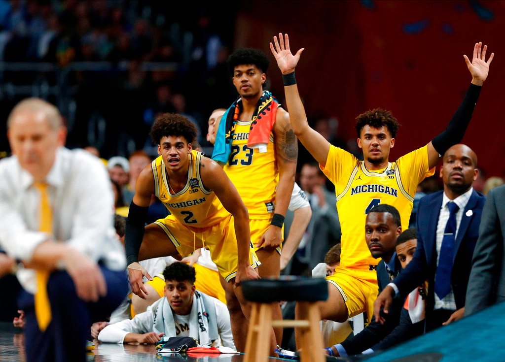 . Michigan players on the bench watch during the second half in the semifinals of the Final Four NCAA college basketball tournament against Loyola-Chicago, Saturday, March 31, 2018, in San Antonio. (AP Photo/Charlie Neibergall)