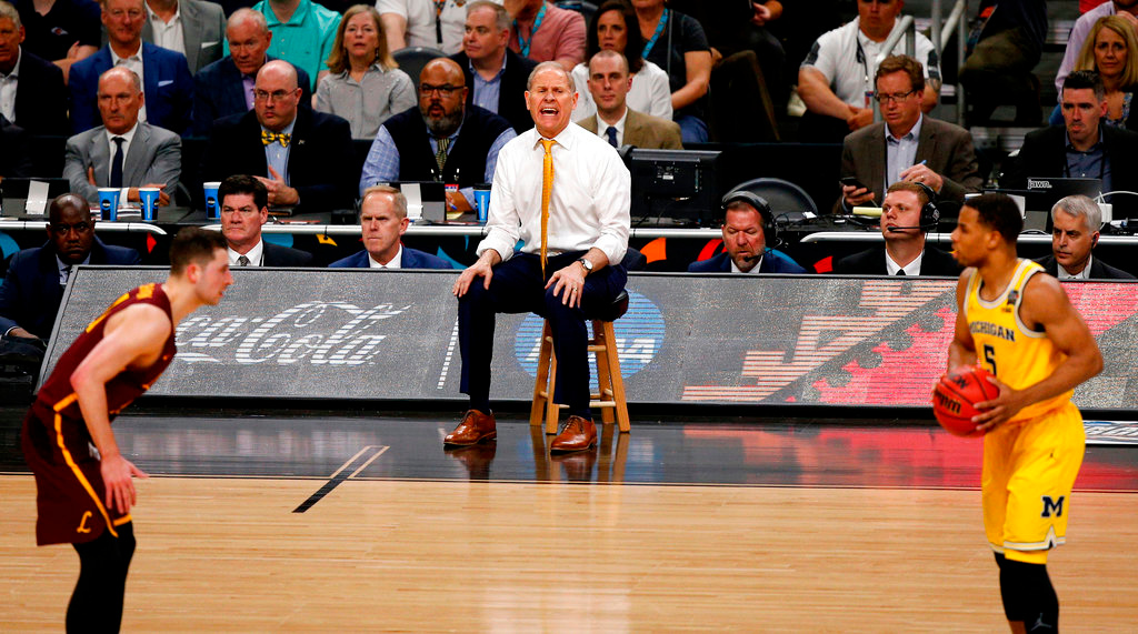 . Michigan head coach John Beilein directs his team during the second half against Loyola-Chicago in the semifinals of the Final Four NCAA college basketball tournament, Saturday, March 31, 2018, in San Antonio. (AP Photo/Brynn Anderson)