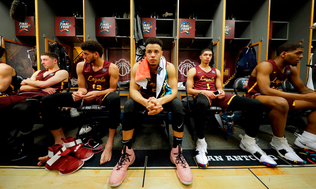. Loyola-Chicago\'s Marques Townes (5) and the rest of the team react in the locker room after the semifinal game against Michigan in the Final Four NCAA college basketball tournament, Saturday, March 31, 2018, in San Antonio. Michigan won 69-57. (AP Photo/Eric Gay)