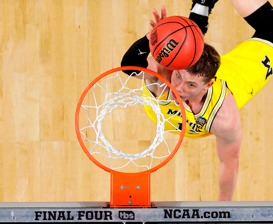 . Michigan forward Moritz Wagner drives to the basket during the first half against Loyola-Chicago in the semifinals of the Final Four NCAA college basketball tournament, Saturday, March 31, 2018, in San Antonio. (AP Photo/Eric Gay)