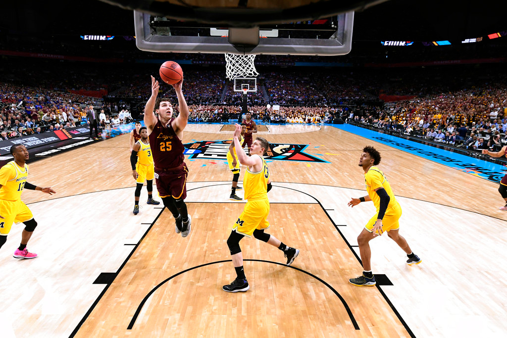. Loyola-Chicago\'s Cameron Krutwig (25) goes up for a shot during the first half in the semifinals of the Final Four NCAA college basketball tournament against Michigan, Saturday, March 31, 2018, in San Antonio. (AP Photo/Chris Steppig, NCAA Photos Pool)